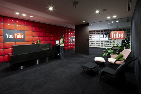 Although owned by Google, the YouTube Tokyo office has its own unique style. Rather than pulling in the bright whites and primary colors of the Google logo, this office uses plenty of black, white, and iconic YouTube red. These choices wind through from the reception area to the studios to the meeting nooks.
