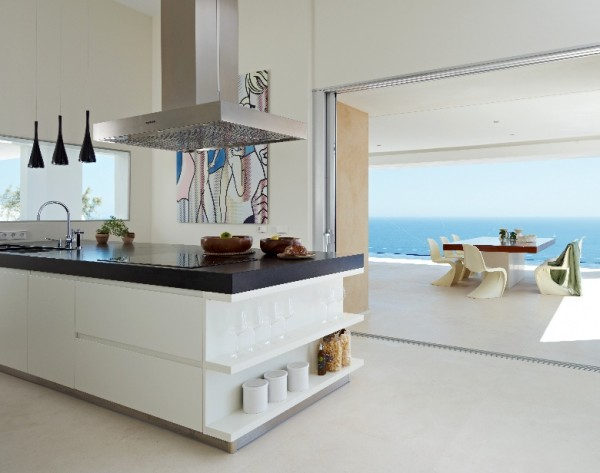 The kitchen is a focal point where people from each of the six en-suite bedrooms can gather day or night. An Italian-style island and range flanked by both indoor and outdoor dining areas.
