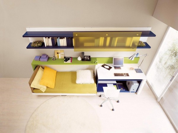 The floor shelf can easily slide underneath the desk surface to make room for this hidden bed.