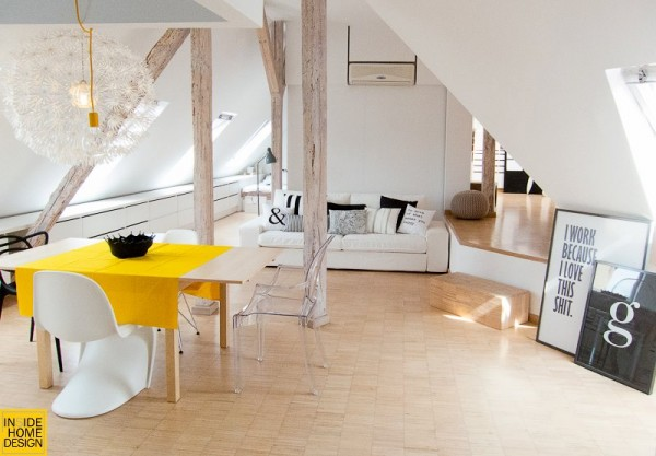 Królikowska redecorated this attic flat for a couple who are both designers themselves. The live/work mixture is always a challenges, but Królikowska manages to bring in elements of the couple's work while still giving them plenty of places to create and to be creative.