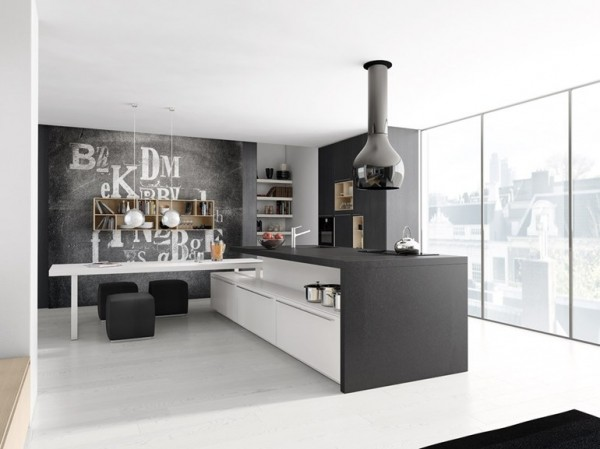 In this monochrome kitchen, what looks like a futuristic light fixture is actually the vent for the stovetop, marrying form with function.