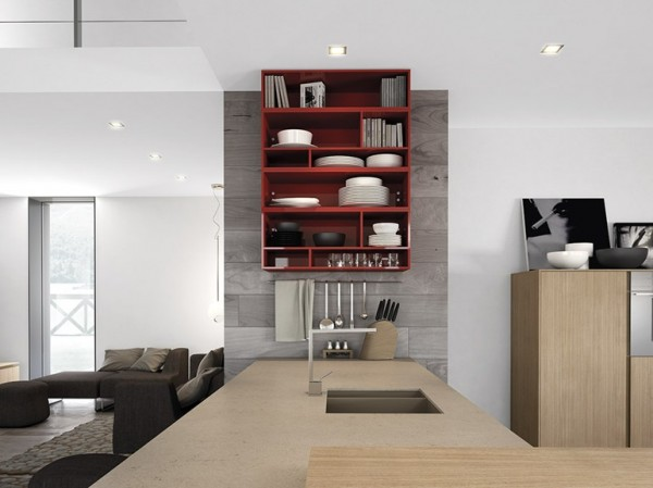 The red wall-mounted shelving forces you to keep things neat, with dishes cookbooks on full display.