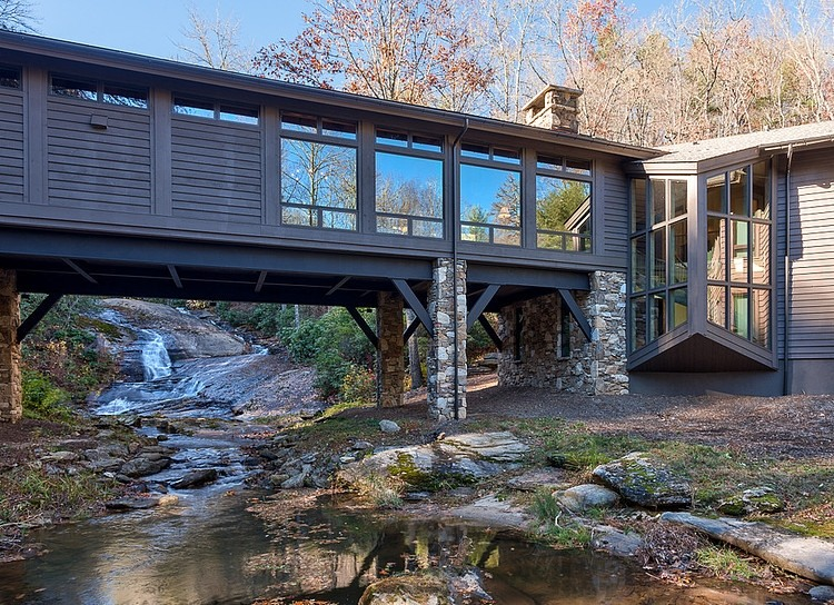 Bridge house home across a stream for Well designed homes