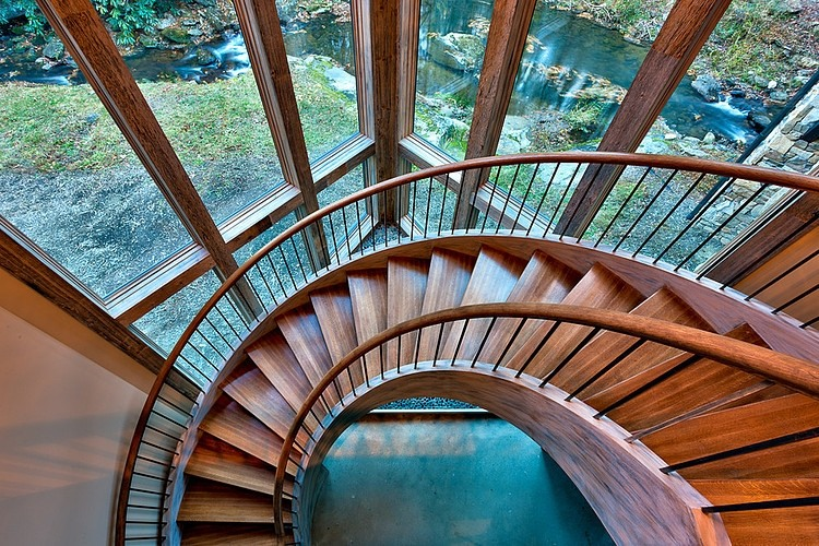 Bridge house home across a stream for Architecture spiral staircase