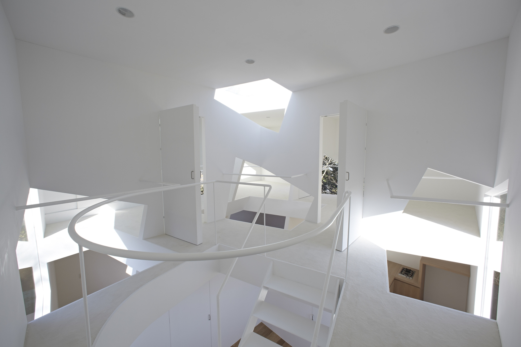 White Staircase - Minimalist home in the mountains
