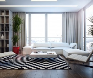 The first apartment has the foundations of a monochrome dream, with striking black and white chevron rug, and snow-white sofa and accent chairs. However, as you wander a little further into the scheme warm notes appear in the form of purposefully placed red home accessories such as a large plant pot and a scattering of rosy vases in the display nooks of the built in bookcase.