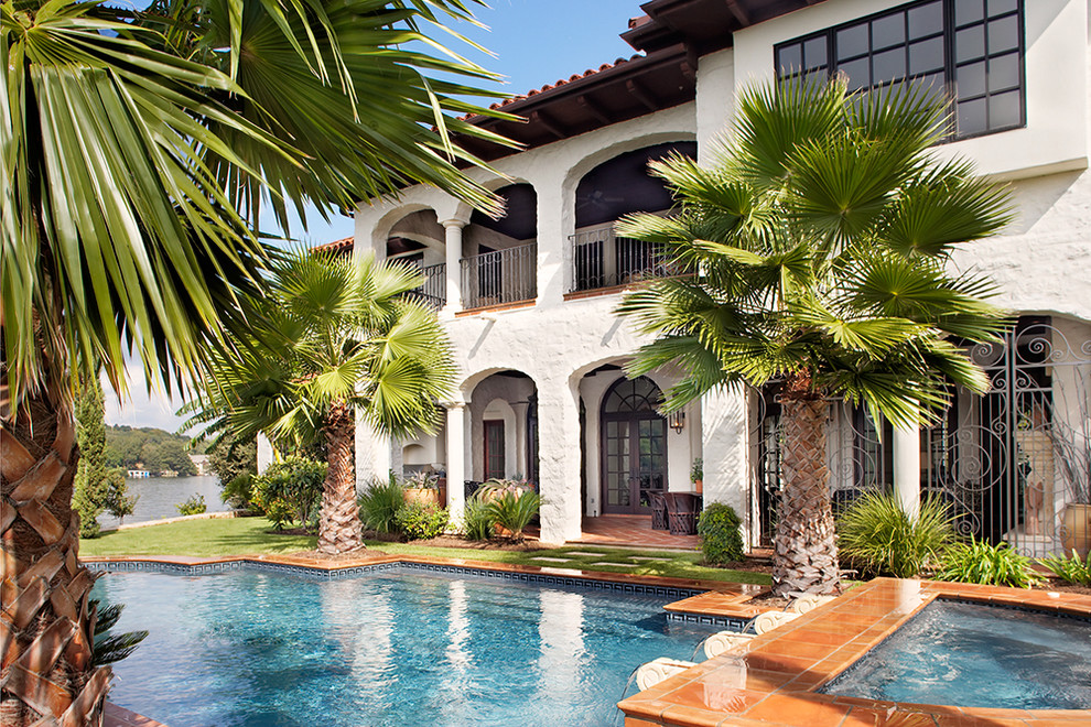 A grand lakeside home with rustic charm for Best palm tree for swimming pool