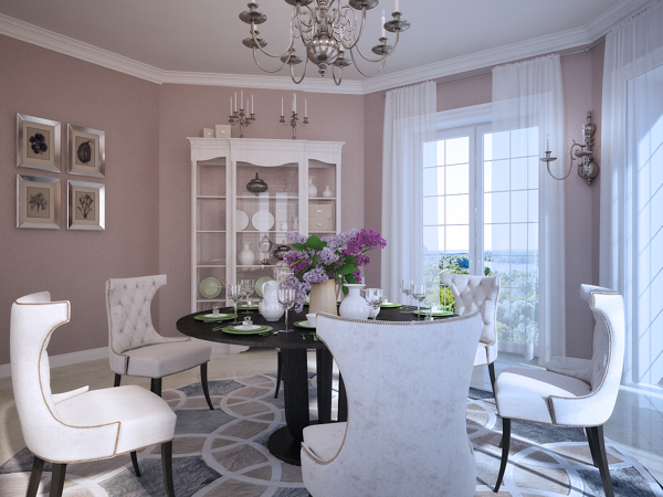Contemporary meets classic in this dining room setup with traditionally upholstered chairs gathered under an unusual mirrored ceiling rose design