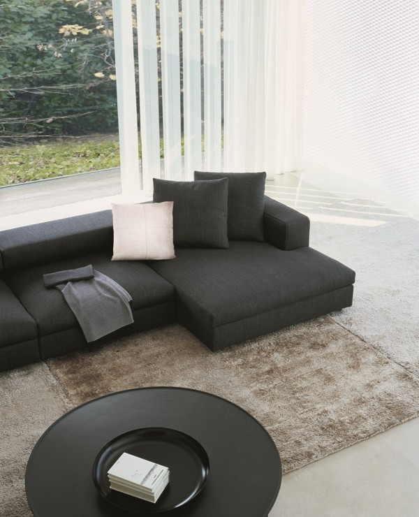 The sharp look of hard-lined sofas can be softened with the presence of adjacent rounder items.