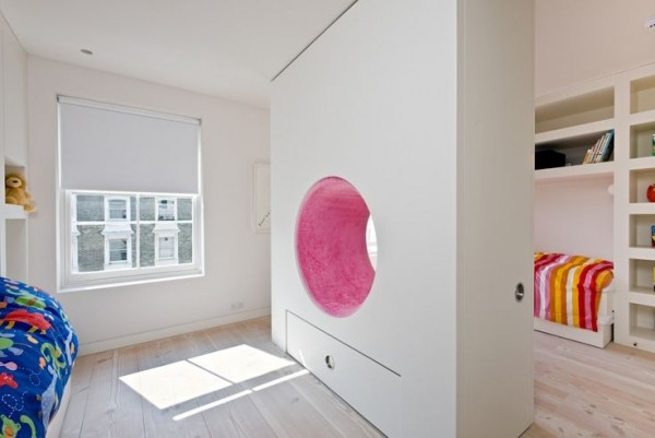 No one said a room divider had to be boring. This pink plush tunnel makes it a bit more fun for kids to share a room.