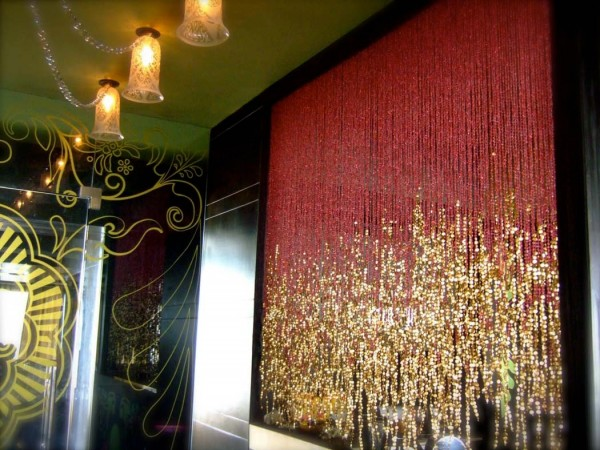 Some room dividers are more nightclub than midcentury. The gold sparkles in this handing curtain are brash and playful in a glorious middle eastern way.
