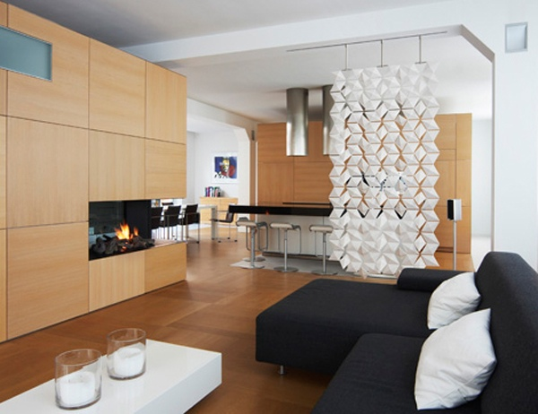 Perfectly contemporary, this artistic white partition suggests separation more than it actually separates.