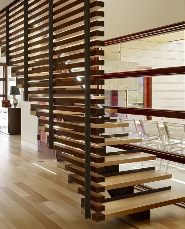 The wood slats that float up with this staircase are a beautiful design element in this wood heavy home.