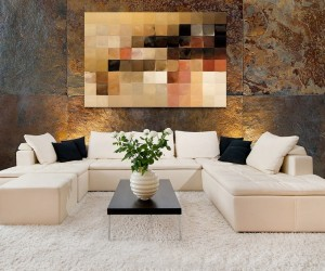 To begin with a neutral palette, like this creamy sofa and rug ensemble, we can see that the series of swatches across the canvass picks up not only the paler hues, but works through the spectrum to tie in every shade right through to the black accent cushions. Of course, your wall art doesn't have to appear as a spectrum, but look for pieces that work all the way though your color story, from light to dark.