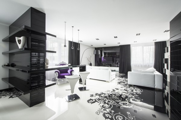 The highly polished monochrome interior design is staged upon an attention grabbing floor treatment, which shows off a slick graphic that waves and swirls down the entire length of the room.