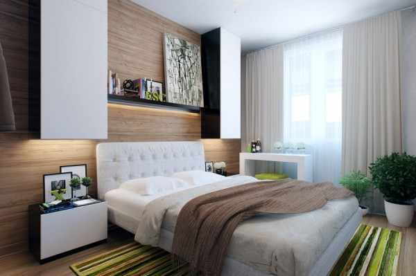 The first bedroom layout shows an unusual wall treatment that incorporates woodgrain to give a cohesive and cozy effect. The panels span the entire headboard wall, decorating the area behind an interesting storage arrangement of wall mounted units hung over bedside cabinets. Beneath each tall wall mounted cupboard, concealed lighting illuminates the obligatory bedside bits and pieces.