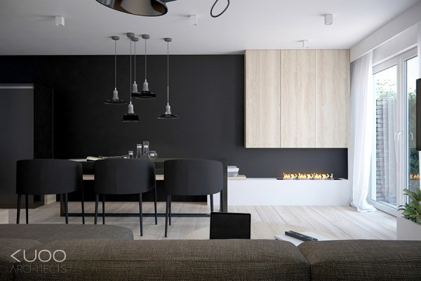 The first is a 105 square meter private home in the Netherlands, which goes bold with a midnight black wall that spans the entire length of the kitchen and the dining area facing the lounge. The dark wall is lifted with addition of a low white unit that holds an open contemporary fireplace, and a pale wooden storage unit. Sheer white curtains let in the maximum amount of available natural sunlight, which bounces over light wood floors.
