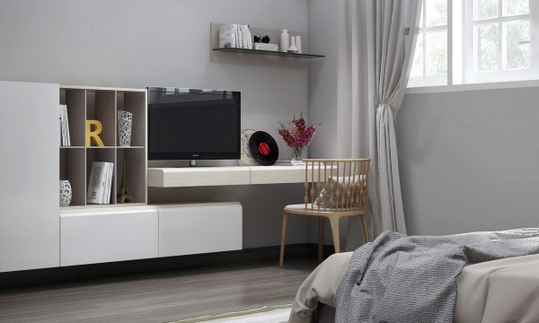 Modular wall hung units are perfect for connecting spaces on any scale, such as this set that wraps beneath a desk to blur the boundaries between TV unit and work zone.