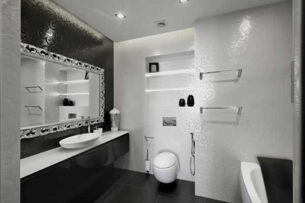 In the bathroom, black and white tiles are engraved with swirling patterns to add extra interest.