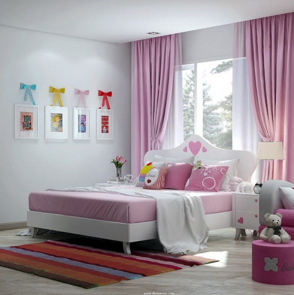 Colorful ribbons add a fancy flourish to plain frames in this girls bedroom.