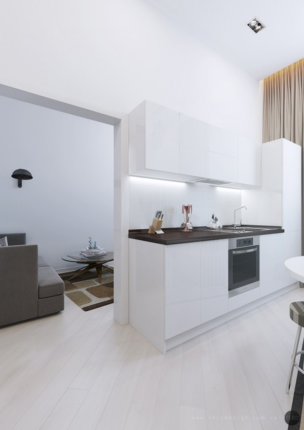 The kitchen units are kept light to prevent the room from feeling too cramped.