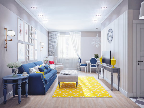 A bright yellow rug livens up the entire space, and balances out the large area of blue created by the sofa and side table.
