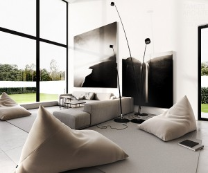 Massive works of art adorn the wall above the sofa, depicting dramatic landscapes in tones of black and white; these compliment the stark black window frames of the towering dual height windows.