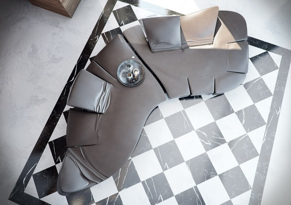A checker board floor sits beneath a curvaceous seat with customizable backrests.