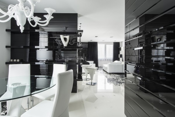 The dining area is surrounded by dark glossy walls for dramatic effect.
