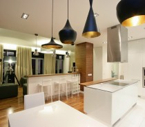 Each dining space in the home is marked out with a run of attractive pendant lights.