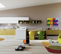 The kitchen units in this room are a sunny mix of yellow and white gloss fronts, but it really is the bright wall art and dining chairs that make this design sing. A nearby lounge area pulls in more color too, with the introduction of a psychedelic feature wall, graphic rug and contemporary sofa.