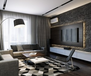 This sophisticated black and gray design uses pattern and texture to bring all of the interest. A large geometric patterned area rug demands attention in the living area, along with a heavily textured feature wall that is highlighted by an illuminated TV surround.