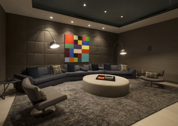 A home cinema room has practical and comfortable seating from which to enjoy the latest blockbuster.