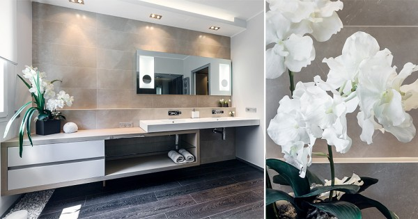 Combined twin basins over an elongated elegant vanity unit creates a luxury bathroom look, and a bespoke shower enclosure completes the plush fitted look.