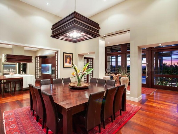 The formal dining area holds a huge square dining table complete with twelve roomy place settings–a great place to hold lavish dinner parties and festive gatherings for the extended family.