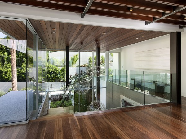 A stunning glass walled mezzanine looks down over the main staircase and out over the property.