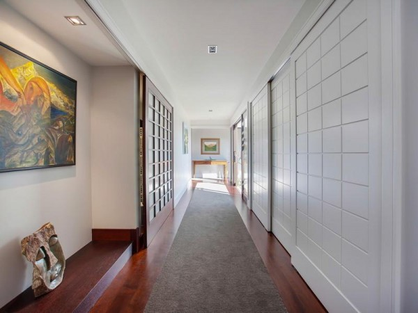Paneled doors flank the halls.