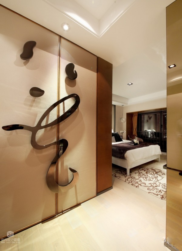 Closet doors in the master bed take on personality with highly unusual handles and 3D flourishes.