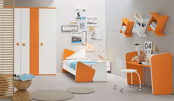 Another gender neutral scheme, this sunny orange and white number with cool blue touches is bright and fun. A few wooden elements adds a tiny dash of sophistication for maturing teenagers. A quirky desk area may help to make study time a little bit more attractive.
