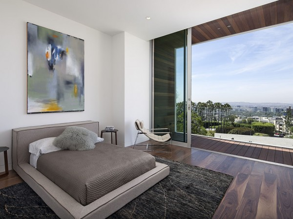The airy bedrooms look out over the views through retractable glass doors.