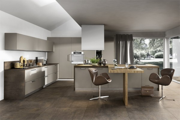 Shades across the brown spectrum may not be the first thing that pops into your head when you imagine a trendy kitchen space, but this design has sandwiched a few together to great effect. The T shaped kitchen island is a really nice touch too if you have that kind of floor space.