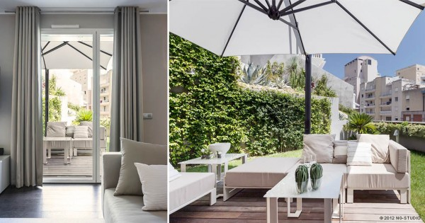 In a lush green garden, outdoor lounge furniture provides a chic place to relax under the sun, or take a breath of fresh air under the shade of an elegant parasol.
