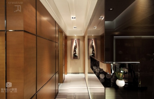 The rich wall paneling is continued even through the hallway space.
