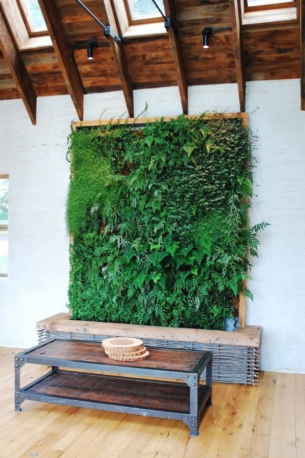 Vertical gardens like this one use up minimal floor space, so you can enjoy a huge amount of greenery in a home that has very little square footage.