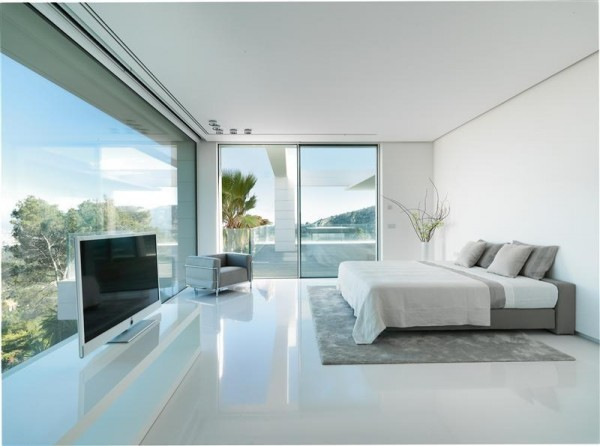 A spacious bedroom suite leads out onto a balcony.