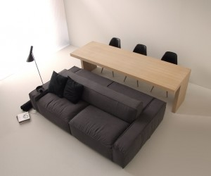 Put simply, Isolagiorno is a dual sided sofa-one side for lounging, the other side for use as a dining bench-plus a matching dining table with just enough overhang to make the whole compact dining experience entirely practical.