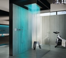 Not everyone has the luxury of an enormous shower room like the one pictured here, but that doesn't mean that we can't take inspiration from its striking décor. Large slate gray tiles look great even in a small room, as large tiles generally increase the look of space in confined quarters. In this example, striking color is washed over the top of the sombre ceramics in the form of bright blue LED lighting. LED lights are great for use in bathrooms, and programmable sets will even allow you to change their color to suit your mood or the time of day.