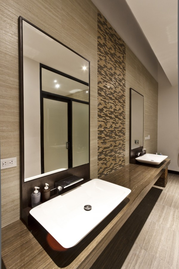 In the luxury bathroom, complete with twin vanity suite, a color palette of earthy tones has been selected to continue the nature theme.