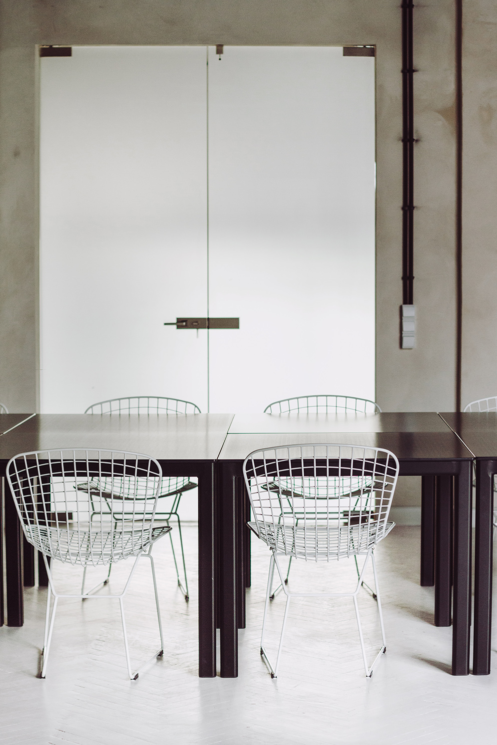 White Metal Chairs - Industrial style apartment with meeting room