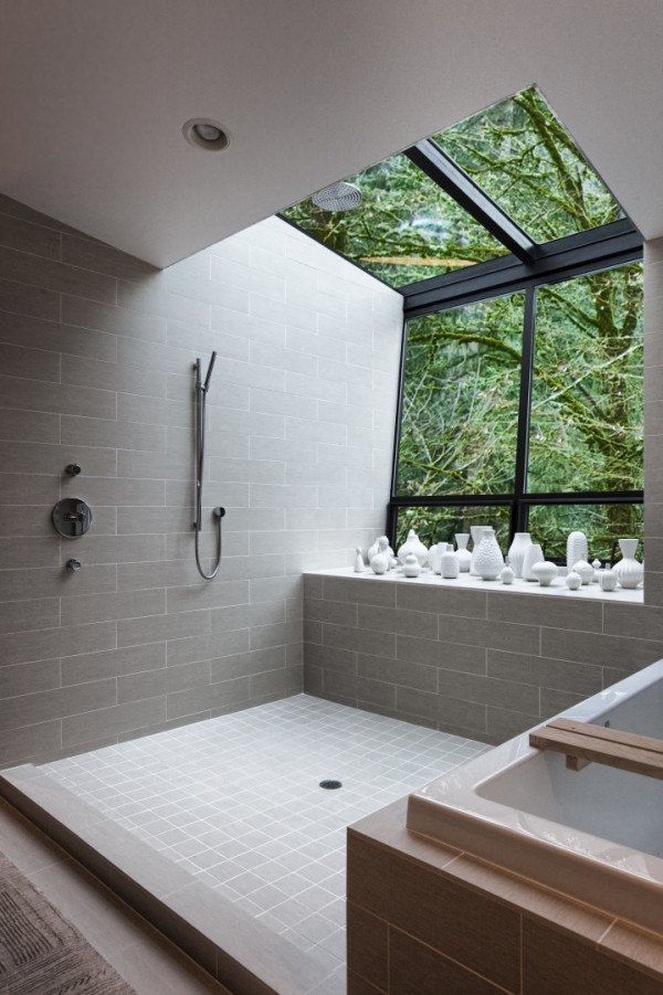 There's nothing quite as liberating as taking a shower in the great outdoors, but if your location or typical weather forecast doesn't allow this luxury, then how about one of these dual aspect windows that look both out and up, forming a cutaway of your room for an outdoor effect.
